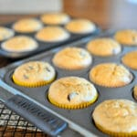 a muffin pan full of just baked muffins