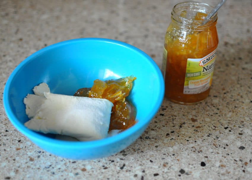 orange marmalade and cream cheese in a blue bowl