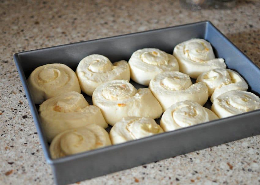 Orange Cream Cheese Cinnamon Roll in a pan ready to bake