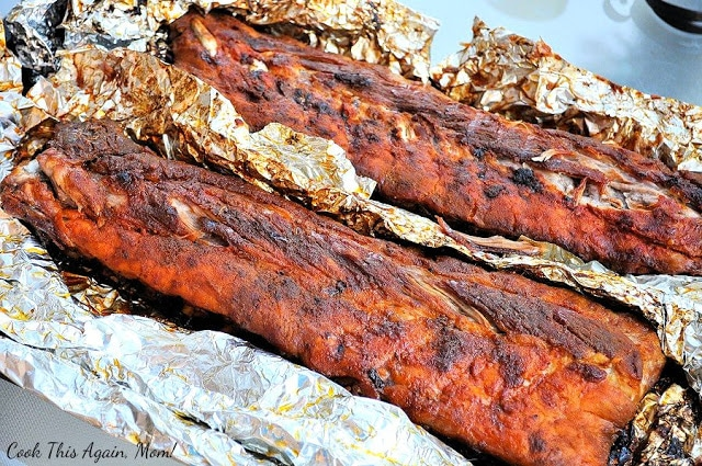 BBQ Baby Back Ribs, cooked, sitting on foil