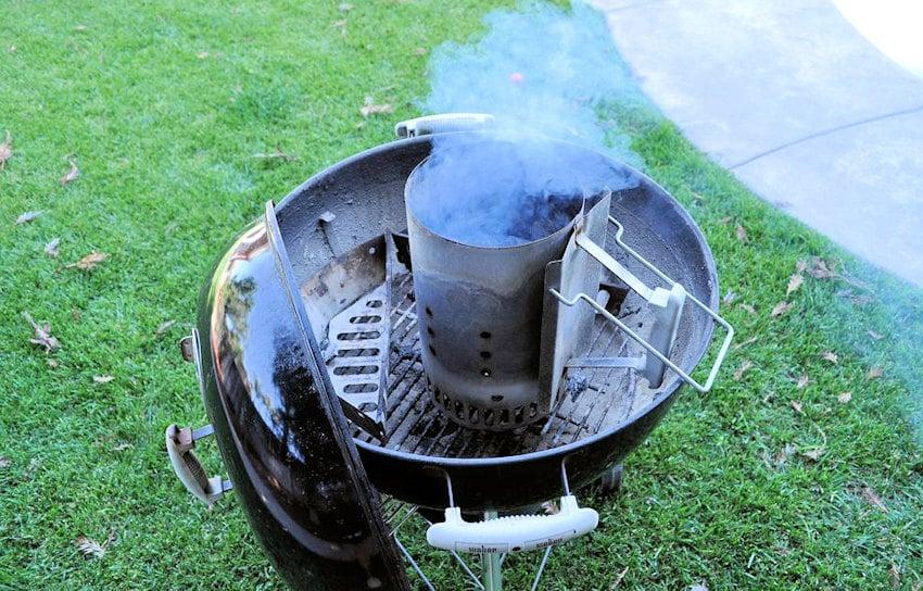 a smoking chimney sitting on a Weber bbq