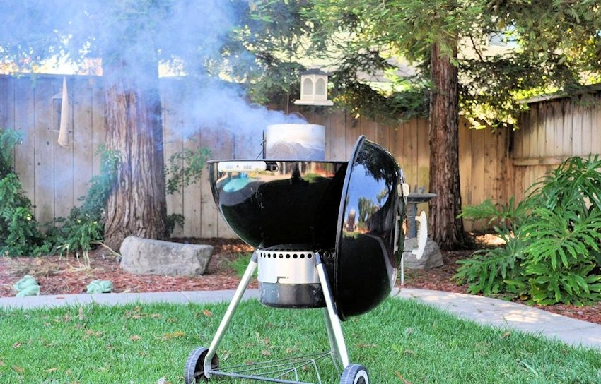 a Weber bbq in our yard with redwood trees in the background