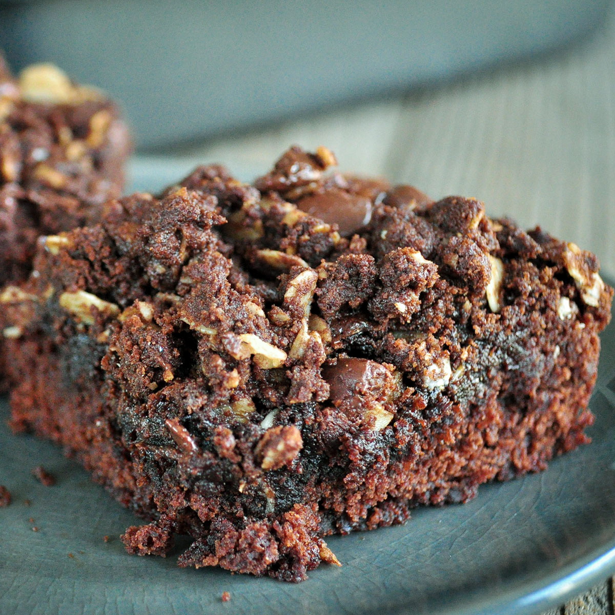 chocolate brownie with crumb topping on a gray plate