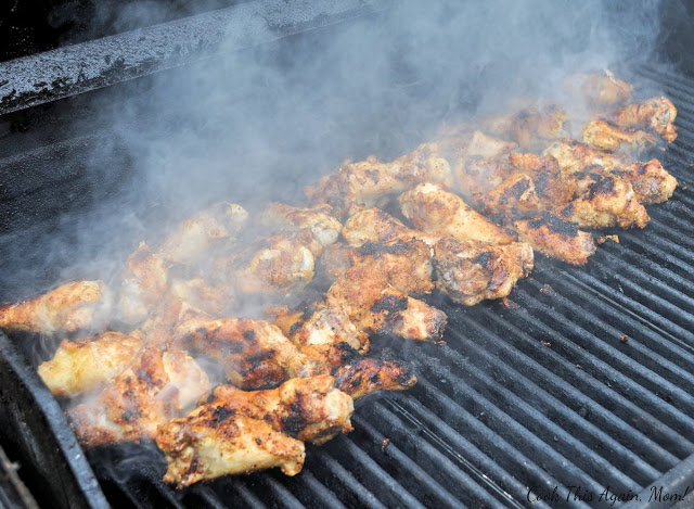 chicken wings being cooked on the grill