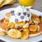 closeup of brown sugared bananas topped pancakes