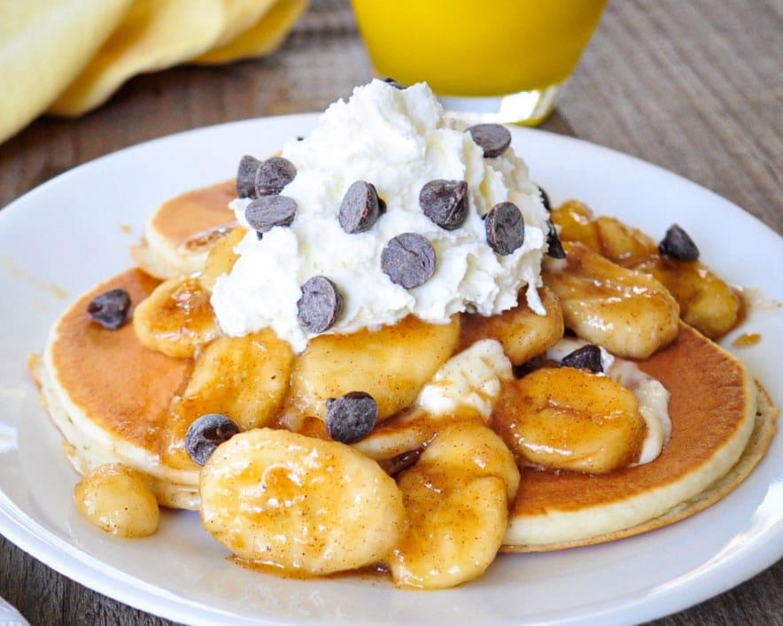 brown sugared bananas topped pancakes