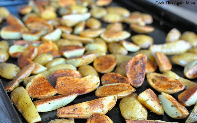 roasted potatoes on a dark cookie sheet