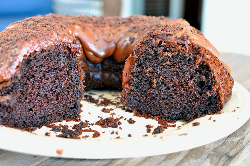 Chocolate Espresso Bundt Cake with a couple slices missing on a serving plate