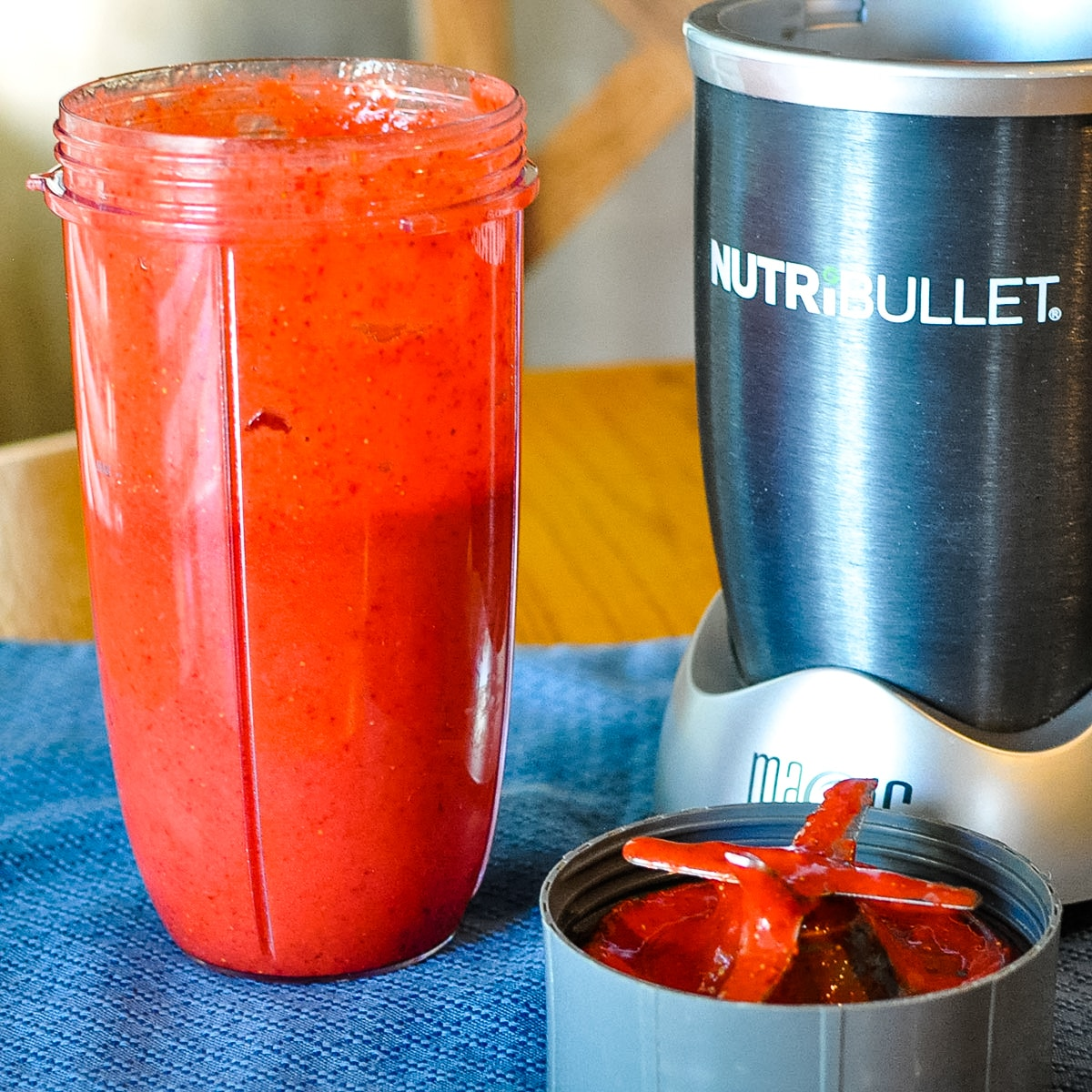 a nutri bullet canister full of fresh strawberries after being pureed
