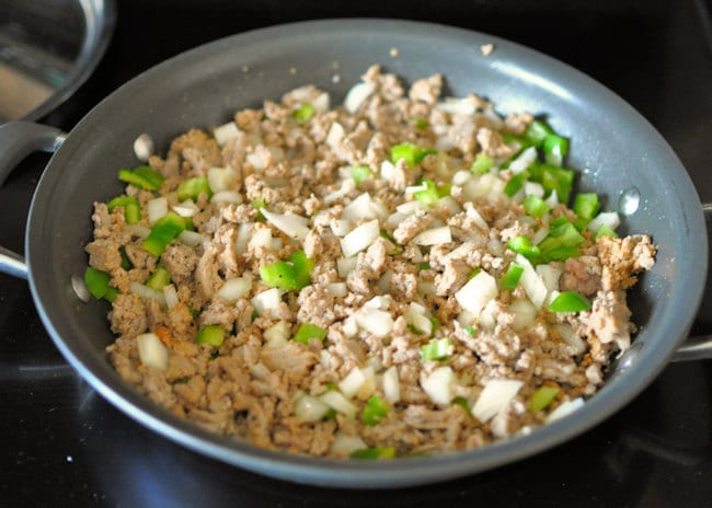 ground meat and onion and pepper cooking for sloppy joes