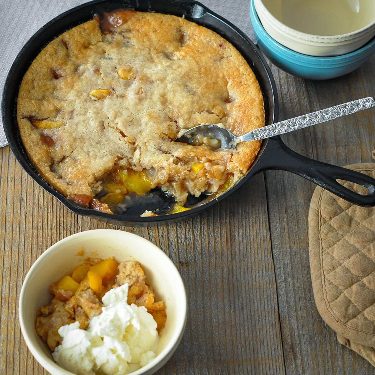 fresh baked cobbler in a cast iron skillet ready to serve