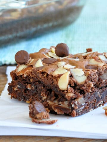 brownies topped with chocolate chips and almonds