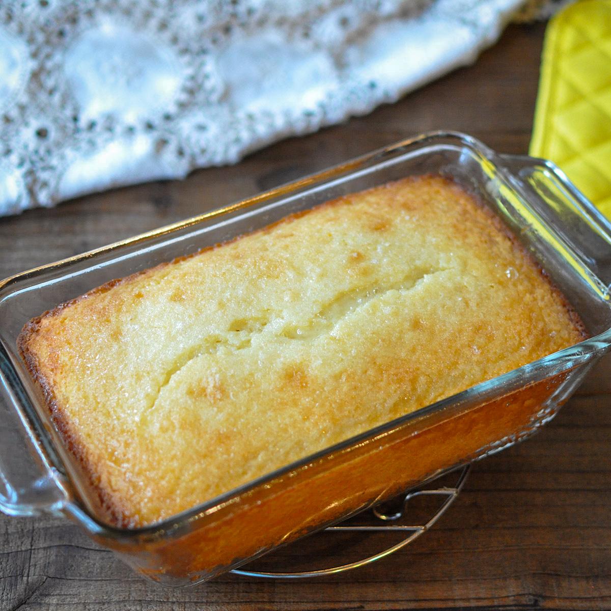 a fresh baked lemon bread in a glass pan