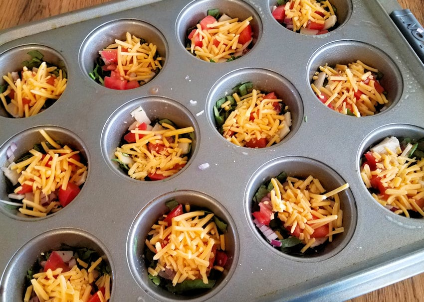 Spinach Egg Cups ingredients in a muffin tin