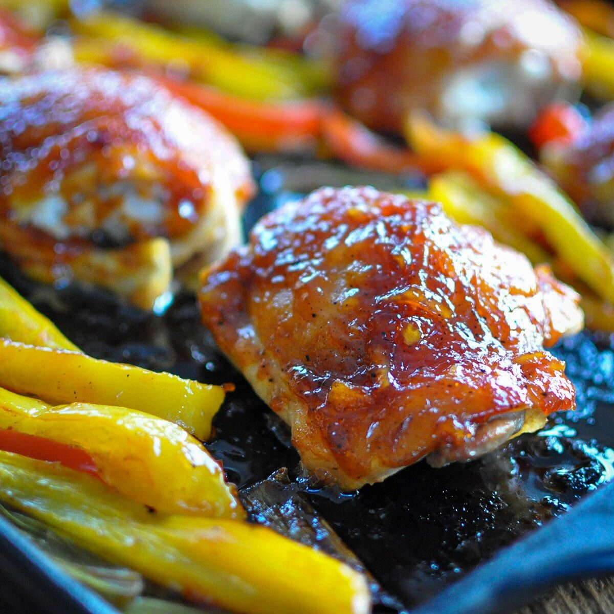 a close up picture of a baked chicken thigh
