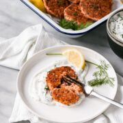 salmon cakes with lemon on a plate