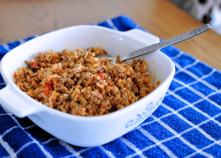 Creole Hamburger and Rice in a casserole bowl on a blue towel