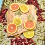 roast salmon with fennel on a baking sheet
