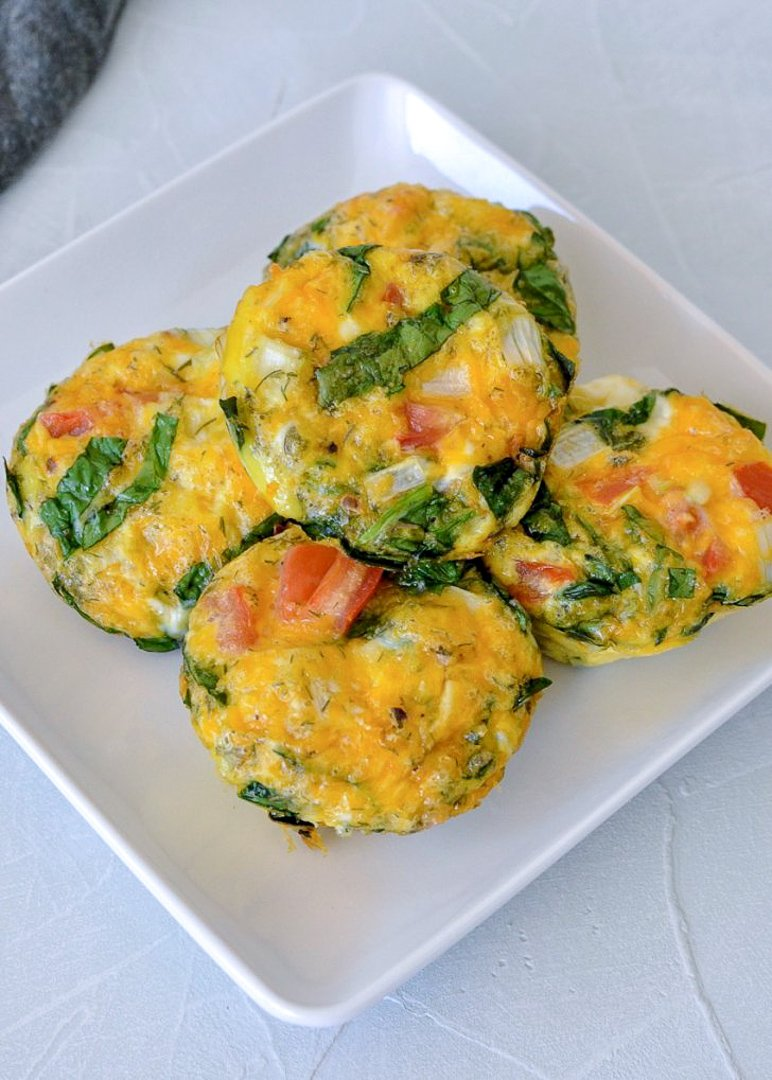 spinach egg cups on a white plate
