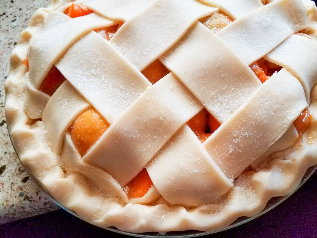 a pie with lattice topping ready to be baked
