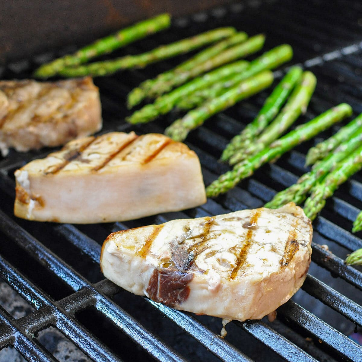 swordfish steaks and asparagus on the grill