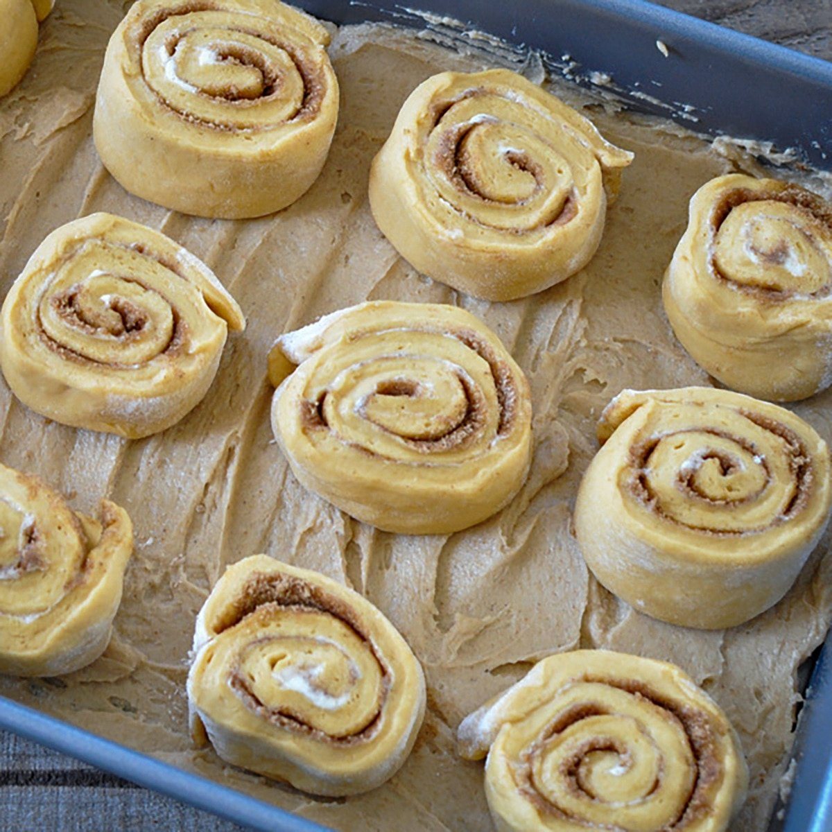 spiced rolls laid in a bed of butter, brown sugar, and corn syrup