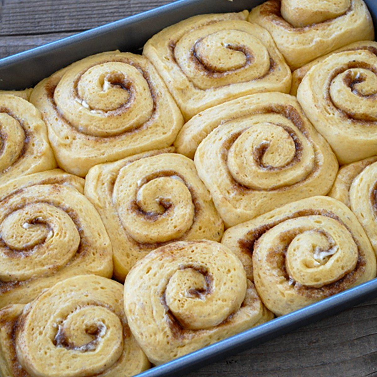 sticky rolls that have raised and are ready to bake