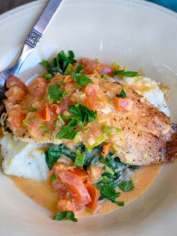 spinach and tomatoes over tilapia over mashed potatoes