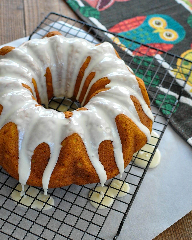pumpkin bundt cake with glaze on a black wire rack