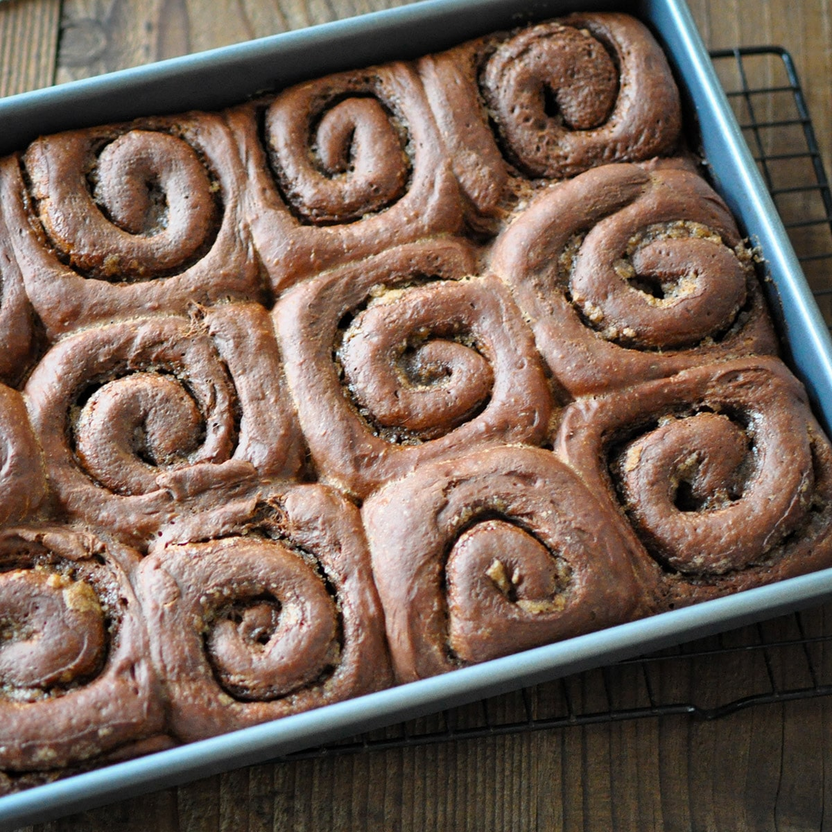 just baked chocolate cinnamon rolls in a baking pan