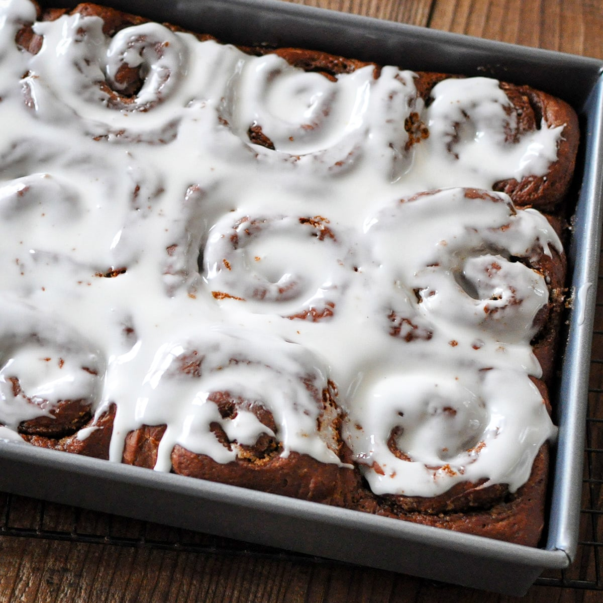 just baked cinnamon rolls covered in icing