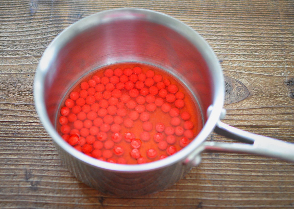 red hot candies in a saucepan with apple juice for a holiday pie