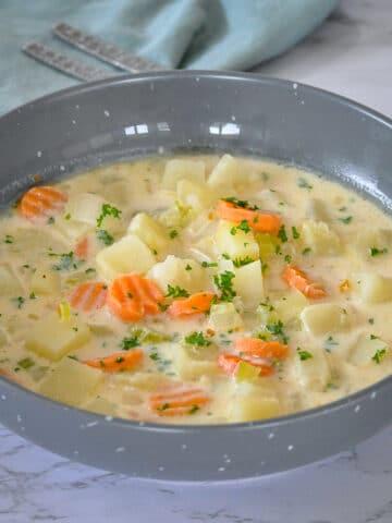 homemade potato soup in a gray bowl