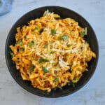 sun dried tomato pasta in black bowl