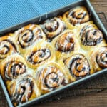 just baked cinnamon rolls drizzled with glaze
