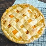 close up photo of a fresh baked apricot pie
