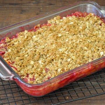 plum dessert in a glass baking pan