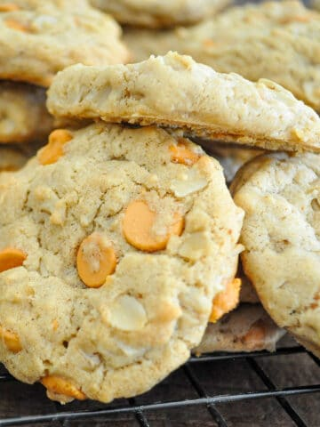 butterscotch chip cookies piled on a wire rack