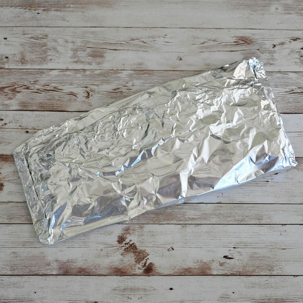 a foil packet of fish ready to bbq