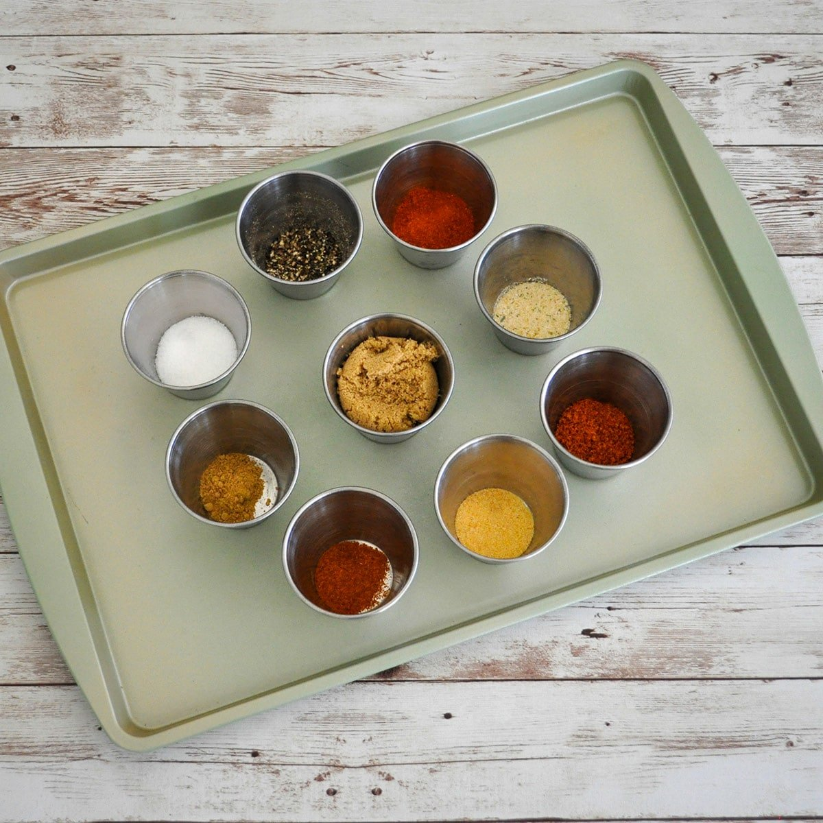 a selection of spices pre measured in separate cups