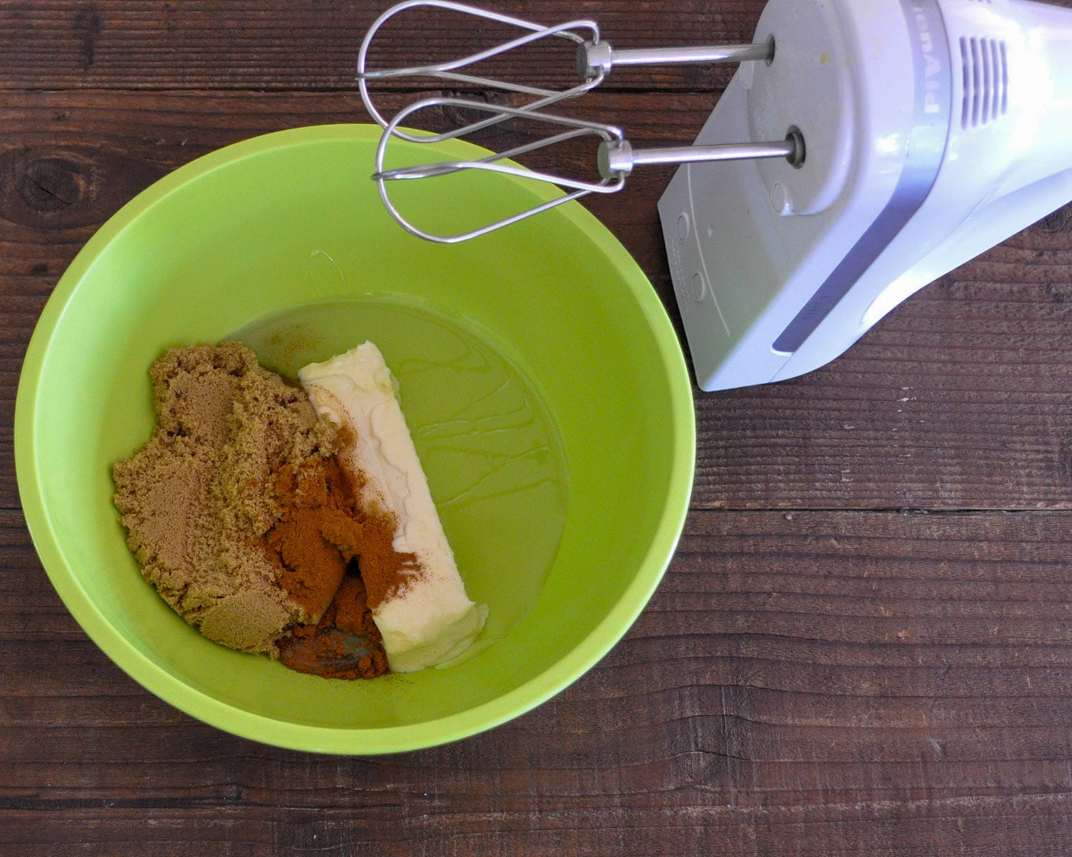 butter, brown sugar, karo syrup and cinnamon in a green mixing bowl
