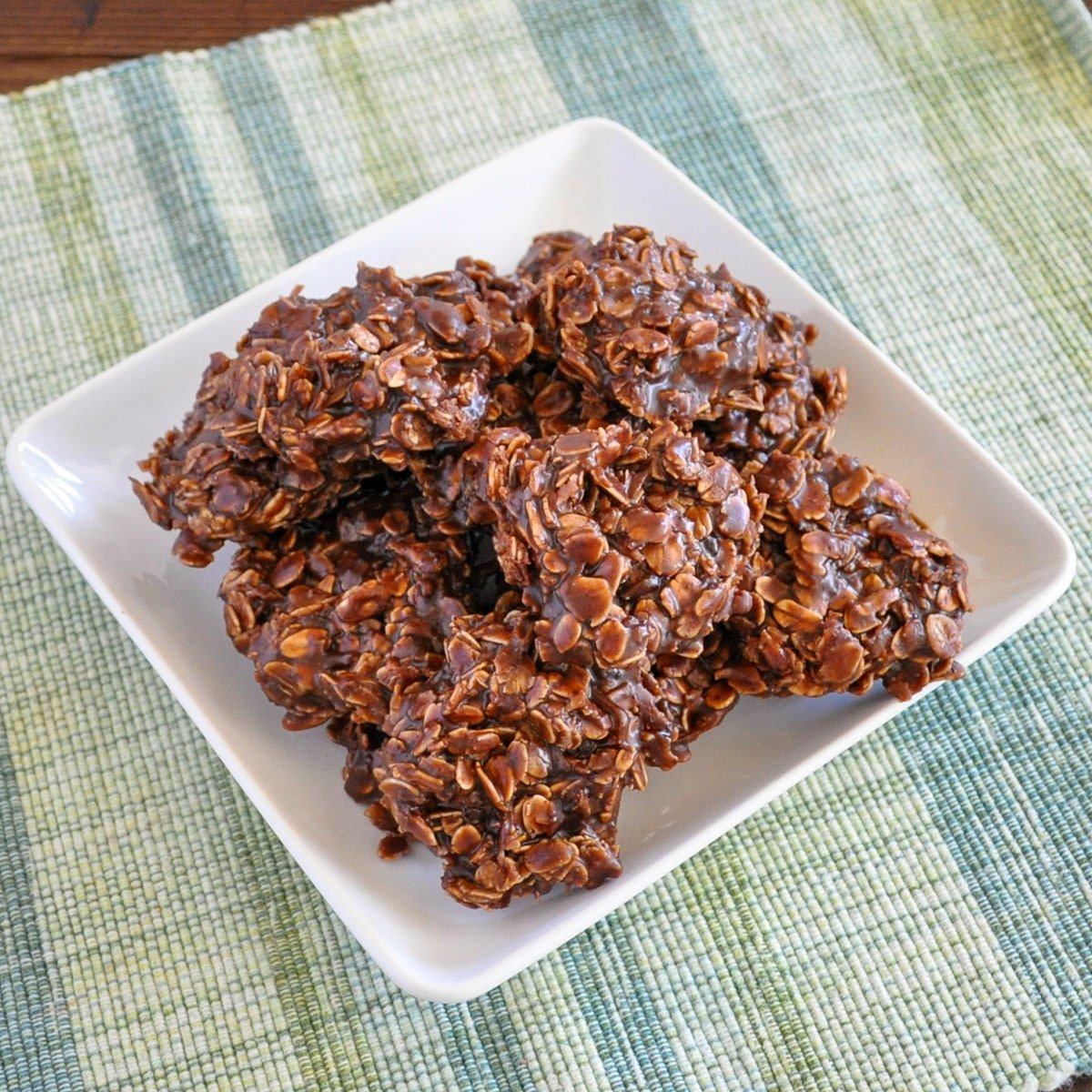 a plate of oatmeal chocolate no bake cookies on a green and blue plaid mat