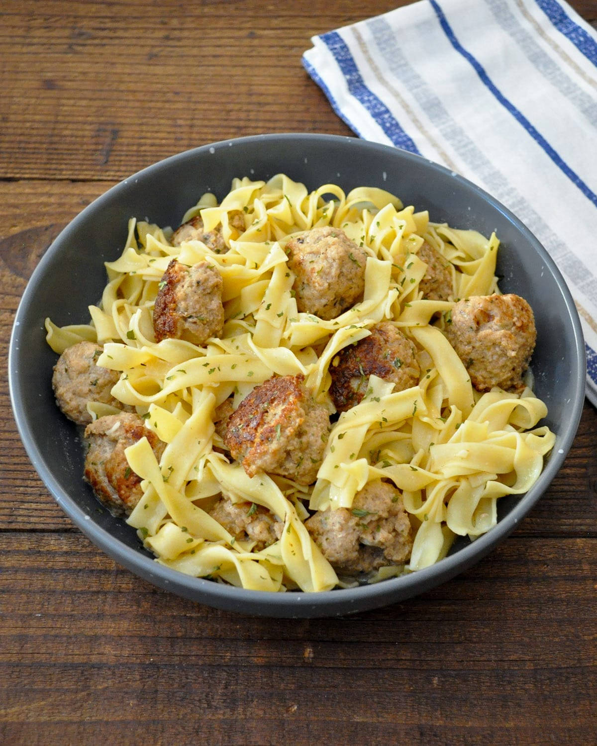 ground turkey swedish meatballs and noodles in a gray bowl