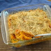 mashed sweet potatoes in a clear casserole dish