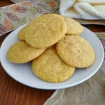 pumpkin snickerdoodle cookies stack on a white plate
