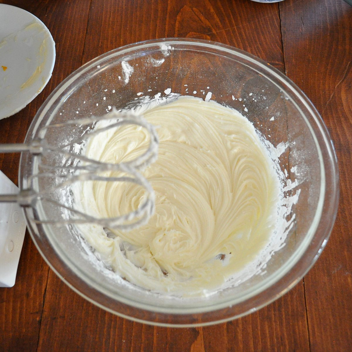 cream cheese frosting in a glass bowl