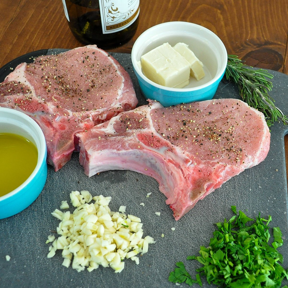 ingredients laid out with uncooked pork chops