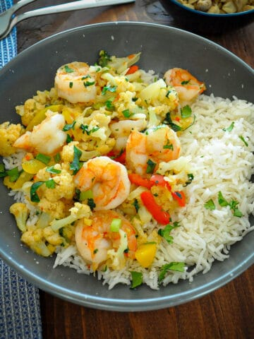 shrimp and cauliflower in a gray bowl with rice