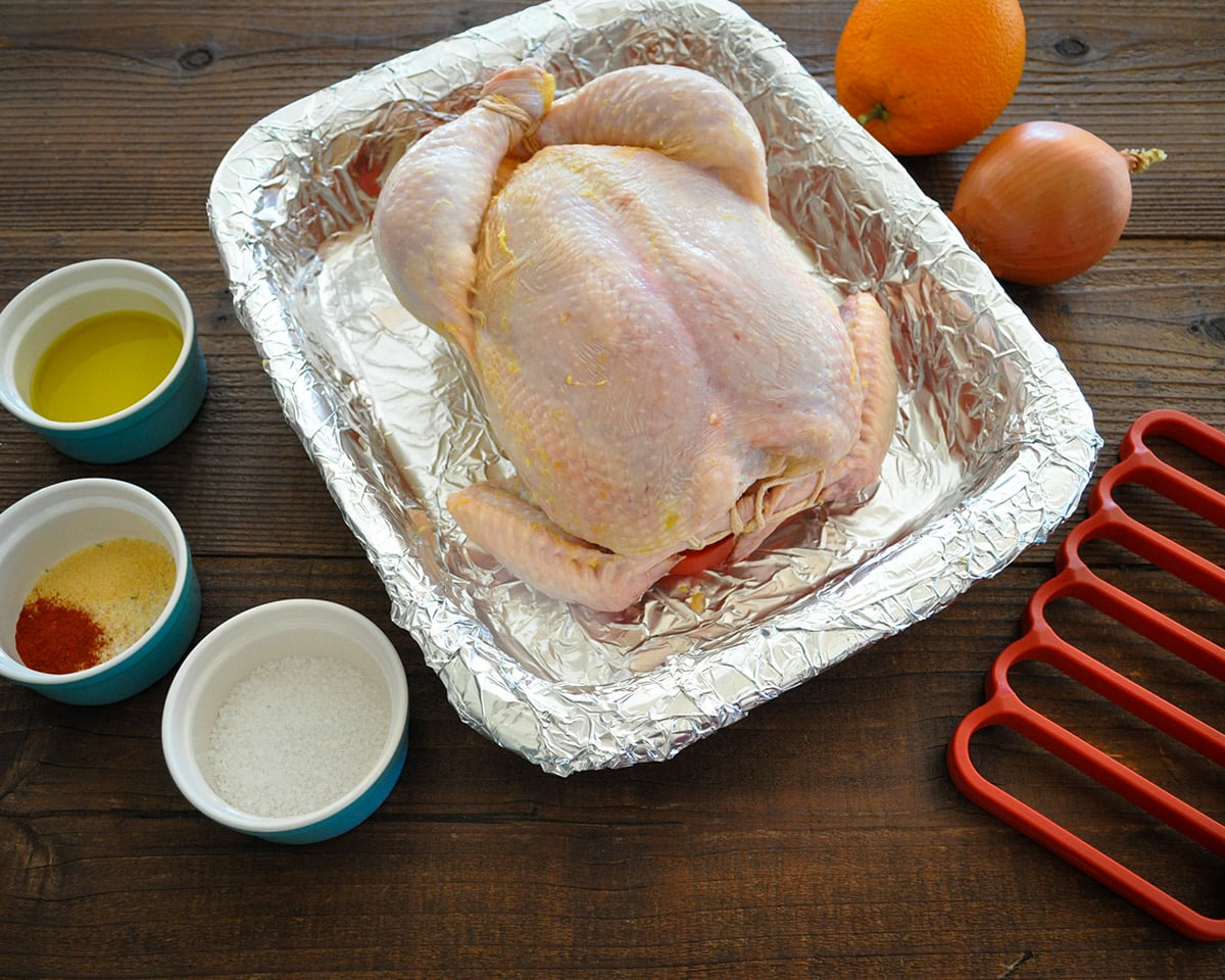 raw chicken and ingredients to season with before roasting