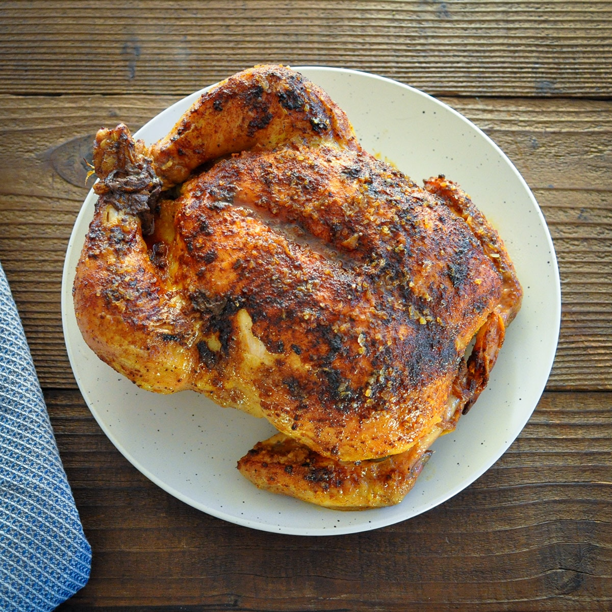 a whole roasted chicken on a white plate